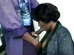 Ebony woman does blow job, vintage..